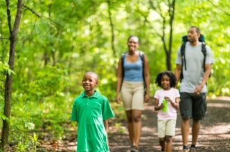 African American family hiking.